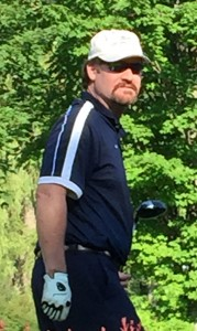 Wade Boggs looks away after hitting his first tee shot.