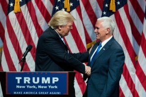 President-elect Trump shakes hands with Vice President-elect Mike Pence (R-IN) at the New York Hilton Midtown as they declared victory. (Getty Images)