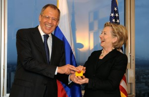 """Russian Reset:"" U.S. Secretary of State Hillary Rodham Clinton with Russian Foreign Minister Sergei Lavrov after she gave him a device with red knob during a meeting on March 6, 2009 in Geneva.  Courtesy: FABRICE COFFRINI/AFP/Getty Images."