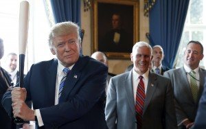 """President Trump hits a home run with blue collar jobs. Earlier this month TheWhite House held its """"Made in America"""" week showcasing U.S. goods like this Marucci bat from Baton Rouge, LA. Vice President Mike Pence laughs behind the Commander-In-Chief. (July 17, 2017, The White House, AP Photo/Alex Brandon)"""