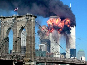 A haunting photo as the second World Trade Center tower explodes into flames after being hit by an airplane, New York September 11, 2001, with the Brooklyn Bridge in the foreground. (REUTERS/Sara K. Schwittek)