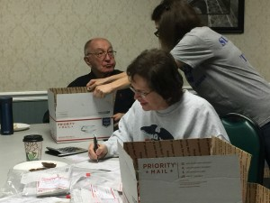 Adopt-A-Battalion volunteers work hard to mail necessities to U.S. military members serving in Afghanistan. (April 22, 2017)